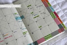 Moleskin notebook transformed into a planner.  Cheaper and custom.  I could make it EXACTLY what I want - I'm outrageously picky about planners.