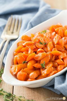 Bourbon honey glazed carrots are easy to make and add a pop of color to your holiday table!  You will love the honey glaze too!