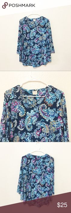 """Chico's paisley print top size 2 large Details: beautiful Chico's top with crisscross straps in the front Size: doesn't have size tag but fits size large according to Chico's size chart which is a size 2.  Material: in photos  Condition: EUC Measurements are taken flat! Chest:   19.5"""" armpit to armpit)  Length:  27"""" (from shoulder)  ☑️ Bundle Discounts  ☑️Fast shipping  ☑️Posh Ambassador  ✨Shop with confidence! Chico's Tops Blouses"""