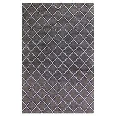 Hand-tufted wool and viscose rug in pewter with a quatrefoil trellis motif.  Product: RugConstruction Material: Wool and viscoseColor: PewterFeatures:  Made in IndiaHand-tufted Note: Please be aware that actual colors may vary from those shown on your screen. Accent rugs may also not show the entire pattern that the corresponding area rugs have.Cleaning and Care: Vacuum regularly and spot clean