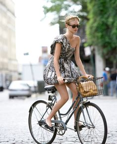 Cute & girly look on a bike... Ballerinas. Dramatic dress. Romantic braid.