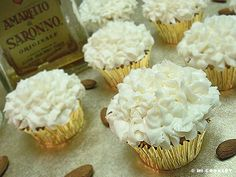 AMARETTO CUPCAKES ==INGREDIENTS== FROSTING== ½ c (1 stick) butter, 1 package (8-ounce) cream cheese, pinch of salt, ½ c almond extract, 3 to 4 c powdered sugar, 1 to 2 T amaretto ==AMARETTO CUPCAKES== 1 box (18.25 ounces) yellow cake mix, 1 package vanilla instant pudding mix, ½ c water, ¾ c amaretto, 4 large eggs, ½ c vegetable oil, ¼ c almond extract ====
