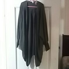 Dark grey open blouse. 3/4 length sleeve Dark flat grey. Textured. Size small. Great over tank tops and a cute skinny pair of jeans and dress it up with an adoreable pair of pumps. Very cute and comfy.TAKE A LOOK!!! POSH AWAY!!! ;) love on a hanger Tops Tunics