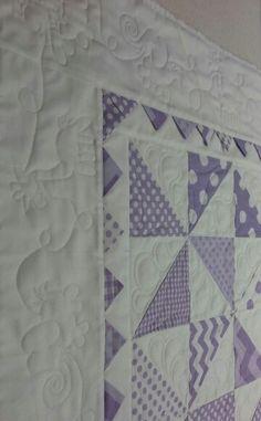 Pinwheel quilt for baby closeup