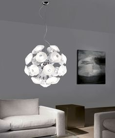 Tike: Pendant lamp composed by 25 borosilicate glass elements in the mirrored or transparent / frosted finishes.