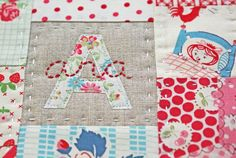 I love the idea of the applique and embroidery over it.    From nanaCompany patchwork placemat