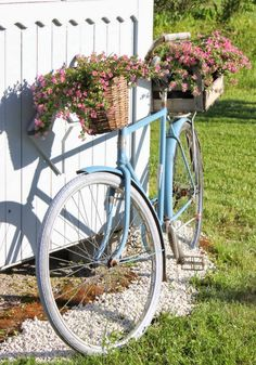 blue bike with baskets of flowers