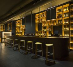 Bar back uses golden paint colour instead of glass or metallics - nice mix with v dark blue Back Bar Design, Bar Counter Design, Pub Design, Bar Interior Design, Restaurant Interior Design, Barra Bar, Modern Home Bar, Deco Restaurant, Home Bar Designs