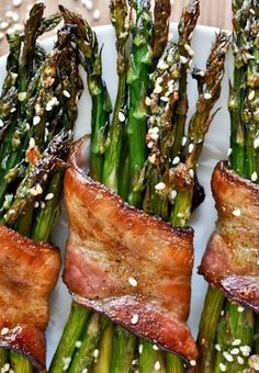 bacon wrapped caramelized asparagus with sesame seeds