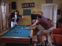 Kramer playing pool in a small room