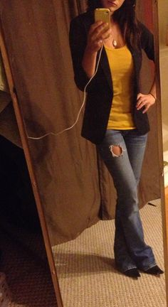 My outfit. Black blazer, mustard tank top, jeans, and black boots :)