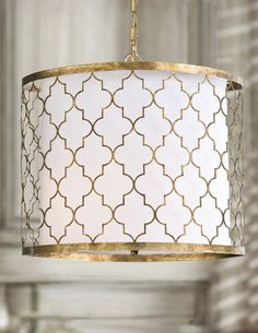 The Moroccan-inspired Metal Patterned Chandelier elevates exotic lighting accessories to new heights.