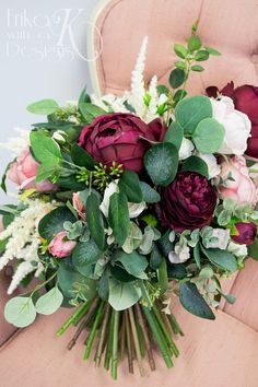 Thank you for visiting Erika with a K Designs! This listing is for a gorgeous artificial flower bouquet created with blush pink and marsala wine colored garden roses, white roses, burgundy ranunculus, ivory astilbe, and a variety of greenery, including eucalyptus. The handle is