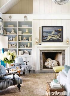 Fill the space of your non used or non working fireplace with some great coastal decor. Ideas are posted on Completely Coastal. The empty fireplace space is a great opportunity to create a focal point display with a coastal, nautical beach theme!