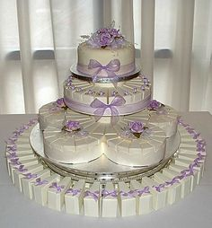 Wonderful display of Cake Slice Boxes.  Boxes  available at http://www.alloccasionsgiftware.com/cat_cake_favor_boxes.cfm