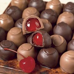 Chocolate covered cherries are really easy to make. Just a few simple steps and you can make this luscious,  candy treat... DIY Chocolate Covered Cherries ~ anything covered in chocolate is divine, when you're ready to wrap and package, impress with red candy foils and cute little candy boxes. Even people who say they don't like chocolate covered cherries like these!