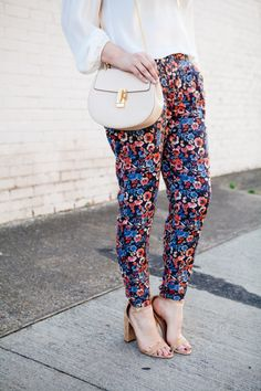 Parker blouse and Joie floral pants by style blogger Kendi Everyday.