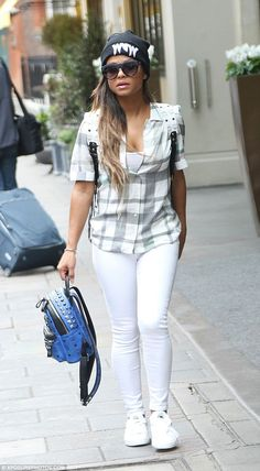 Low-key look: The 33-year-old singer was sporting skinny jeans and a white and grey checke...
