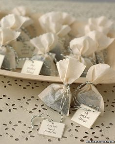 "Tea bags tied with baker twine. Trimmed with scalloped scissors and filled with loose leaf tea. :-D ""tea filter bags"" available at Amazon"