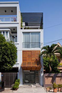 MM++ architects townhouse with a folding-up shutter ho chi minh city vietnam designboom