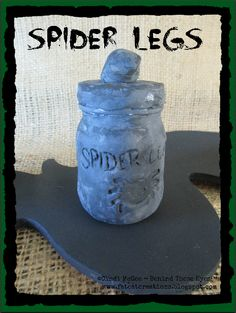 Spider Legs altered aspirin bottle for Witch's Apothecary for Halloween - made with Makin's Clay® no bake air dry polymer clay by Cindi Bisson McGee - http://www.makinsclayblog.blogspot.com/2015/09/witchs-apothecary-by-cindi-mcgee.html