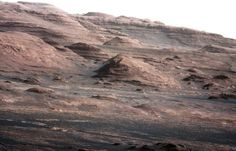 On Aug. 27, NASA released a high-resolution shot of the dark dunes and layered rock at the base of Mars' Mount Sharp, Curiosity's eventual destination. The image, which was taken on Aug. 23, looks south-southwest from the rover's landing site. The top ridge of the distant mountain is about 10 miles from the rover.