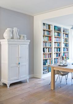 Painted white armoire / wardrobe for storage in the living room. I wonder if these bookshelves would work in our dining room? Home Living Room, Interior Design Living Room, Living Room Decor, Living Spaces, Interior Decorating, Style At Home, Home Office, Billy Ikea, Regal Design