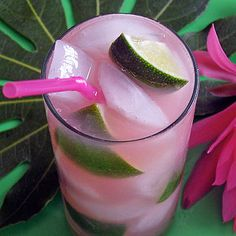 "Tickled Pink Tropical Island ""Iced Tea"" serves 1 1 oz Captain Morgan's spiced rum 1 oz gin 1 oz vodka 1 oz tequila 1 oz Cointreau or triple sec 1 oz fresh limejuice 2 oz guava nectar (such as Kearns) 2 oz club soda (or to taste) Lime wedges as garnish Pour all the ingredients into a large, tall 10-14 oz ice-filled Collins or Chimney style glass. Top with the club soda and gently stir. Garnish with as many fresh lime wedges as you like."