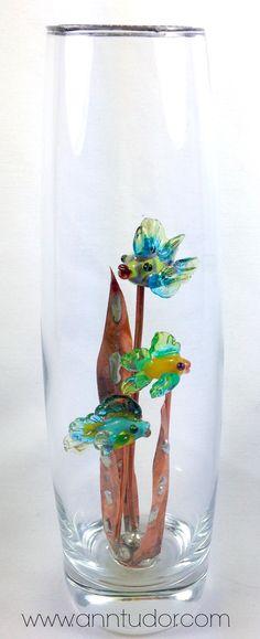 This little aquarium is filled with three miniature handmade lampwork fish swimming in copper kelp. $40 www.anntudor.com