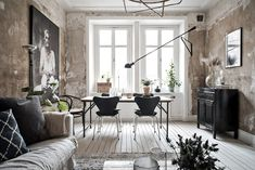 You either love or hate this look in the living room - the raw walls that looks like you're just about to paint them or p...