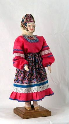 A doll in a traditional costume for the field works. Yaroslavl Province, Russia; a fashion of the 19-th century.