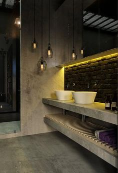 Ambient lighting in bathroom. Mellow, moody and somewhat broody; this ambient lighting gives you enough illumination to see what's inside this concrete-themed bathroom, minus the glare