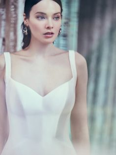 Maggie Sottero - TEAGAN, For a timeless yet striking statement, consider a simple fit-and-flare wedding dress in Mikado satin. (And for a luxe and comfortable feel, opt for this one with built-in shapewear.)