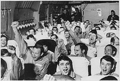 """Former Vietnam Prisoners of War cheer as their aircraft takes off for home in February 1973. """"Operation Homecoming"""""""