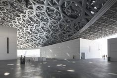 Image 29 of 45 from gallery of Jean Nouvel's Louvre Abu Dhabi Photographed by Laurian Ghinitoiu. Photograph by Laurian Ghinitoiu Jean Nouvel, Louvre Abu Dhabi, Arch Architecture, Architecture Interiors, Museum Exhibition Design, Chandelier, Ceiling Lights, Gallery, Space