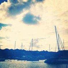 Sundown in St. Barth by the docks. The water is so beautiful & so are the boats.