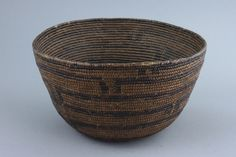 Africa |  Basket most probably from Angola that is circular in shape, with a decoration of black geometric motives.