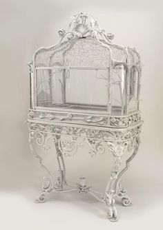 Victorian terrarium - love the spiderwebs up top.