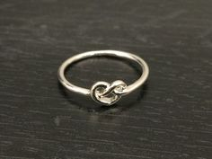 Silver Knot Ring Sterling Silver for you or someone you love. Sterling silver is the standard for beautiful high-quality silver jewelry and can not be replicated by lower priced silver plated jewelry.