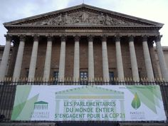 A COP21 climate conference sign in front of the Palais Bourbon, the meeting place of the the French National Assembly, the lower legislative chamber of the French government. Photo by Brian Kaylor.