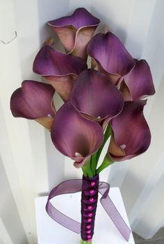 Calla lily Wedding bouquet plum purple real touch Bridal bouquet & boutonniere. $60.00, via Etsy.