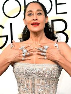 "Total Carat Count: A LOT! The Black-ish star (who nabbed the Best Actress Golden Globe for a TV Comedy Series) decked her digits with a ring on every finger, courtesy Yeprem, Kavant & Sharart fine jewelry, Noudar, L'Dezen by Payal Shah and Hueb. ""I'm hoping to abscond with them and buy a house,"" Ellis Ross told PEOPLE on the carpet of her bling. ""I think I will hock them and give all the money to Planned Parenthood and the ACLU. It's that kind of year, folks."""