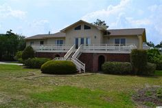 This home & lot is a lower price than the three other corner lots active on market. Also; best ocean views from all front windows The best 2nd row location in North Litchfield Beach wih expanded OCEAN VIEWS. This would be awesome for the person who has a flair for remodeling, decorating & furnishing BEACHY. Could also be a permanent residence.LARGE CORNER LOT ACROSS FROM ONE OF THE LARGEST  BEACH ACCESS AREAS IN NORTH LITCHFIELD. MID BEACH ARE...