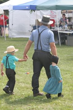 Amish father with two children