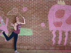 interactive chalk murals. The idea is to create murals on the wall of the courtyard where other students can take photos of themselves interacting with the murals.