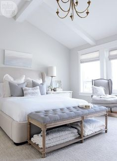 Bedroom decor ideas - Classic style bedroom with tufted bench and upholstered headboard in great and white color palette.   Style At Home