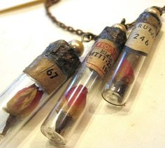 I don't know if I'd do a rose, but these vials look cool because they are so old (or old looking) - -- Rose in Vial