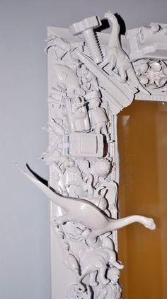 glue toys to a mirror & spray paint.