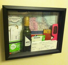 Vacation shadow box using mostly all tickets from the trip.