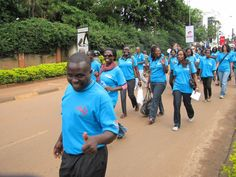 Volunteers give broad smiles as they march during the celebration of the tenth anniversary of the International Year of Volunteers, Monday, 5 December 2011. Photo: Moses Ojota  — at Uganda.